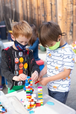 Learning through play helps children develop problem solving skills as they learn to work together.